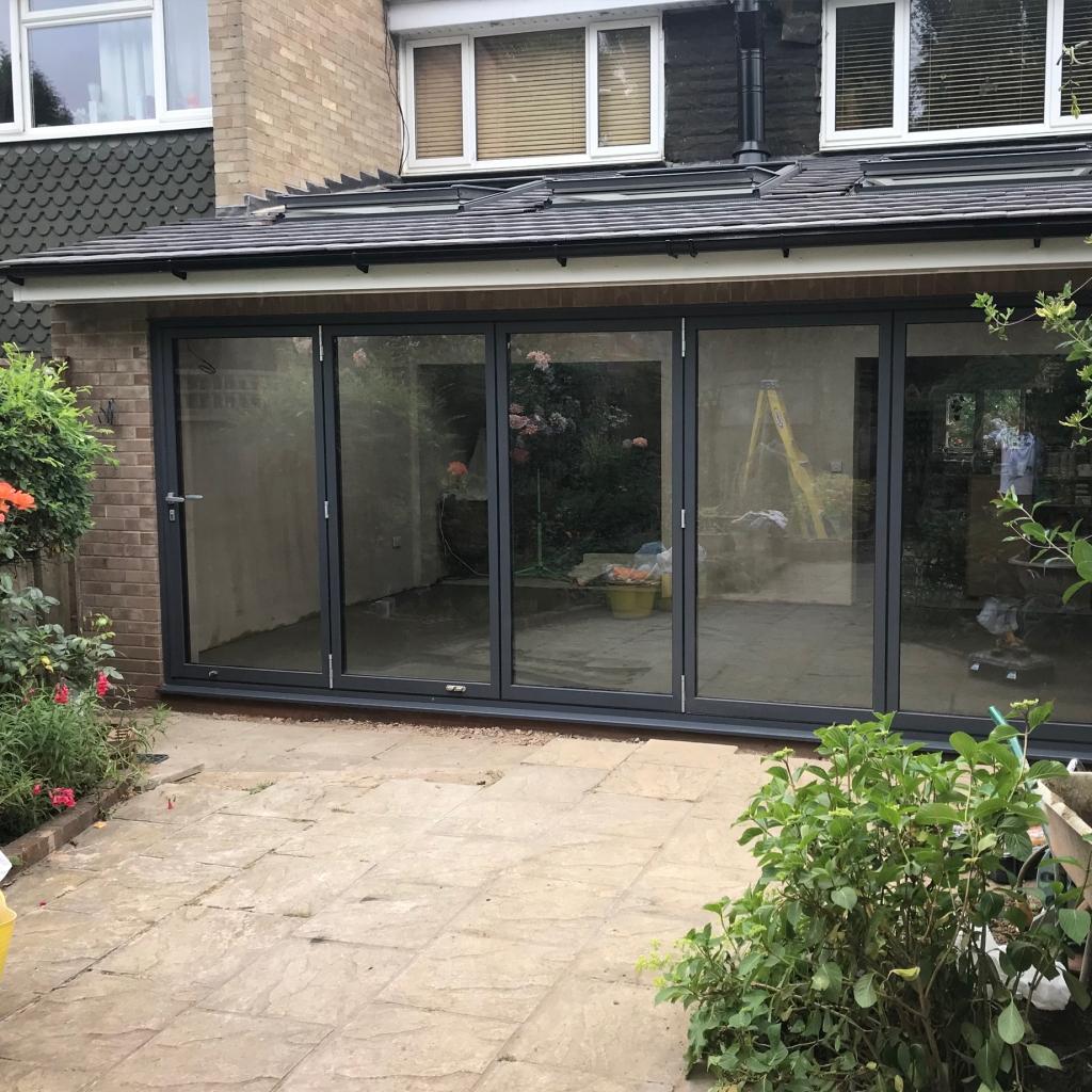 Single storey extension in Egham, Surrey with bi-fold doors.